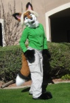 anthro biped blonde_hair bottomwear canid canine cargo_pants clothed clothing costume don't_hug_cacti female fox fursuit green_eyes hair hoodie mammal open_mouth outside pants paws real rusc solo standing topwear unknown_artist