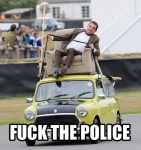 2011 car chair clothed clothing derp_eyes driving english_text footwear fuck_the_police fully_clothed group human human_only humor image_macro legwear lol_comments male mammal mini_(car) mr._bean mr._bean_(series) not_furry outside pants police reaction_image real recliner rowan_atkinson shoes socks solo_focus text tongue tongue_out unknown_artist vehicle
