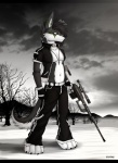 2012 anthro belly black_fur black_nose canine clothing cloud collar fur gun hi_res intervention_sniper jacket male mammal navel nyrumx nyrumx_(character) pants ranged_weapon sniper solo weapon white_belly white_fur